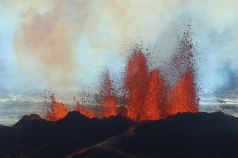 Fountains of lava, up to 60 meters high, spurt from a fissure in the ground on the north side of the Bardarbunga volcano.