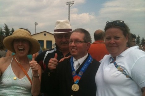 Equestrian gold medal winner Steven Yetman celebrates yesterday with his parents and coach