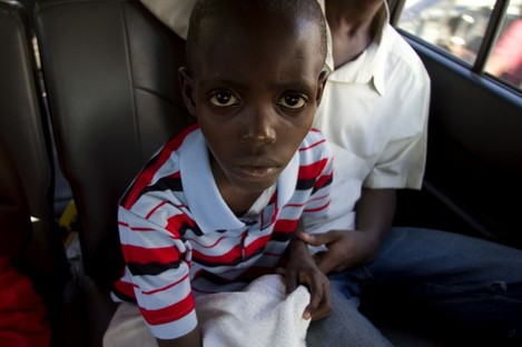 Hundreds of thousands of Haitians like this young boy have been affected by the cholera outbreak.