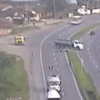 Watch this biker's incredible escape by sliding under a truck Hollywood-style