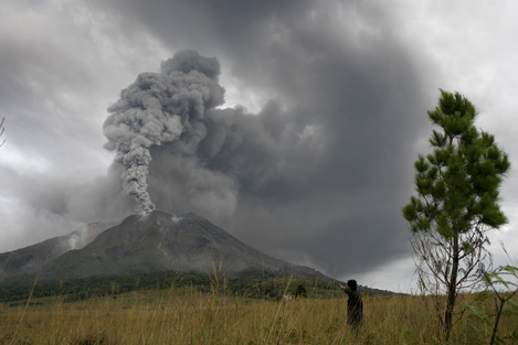 Mount Sinabung spews volcanic materials into the sky in Karo, North Sumatra, Indonesia, today.