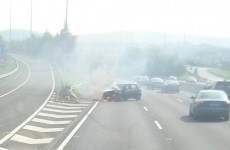 Woman taken to hospital after car bursts in to flames on M50