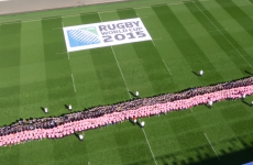 More than 1,000 people set a new world record for the largest ever scrum