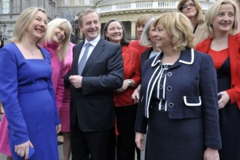 Taoiseach Enda Kenny surrounded by several female parliamentarians at Leinster House (File photo)