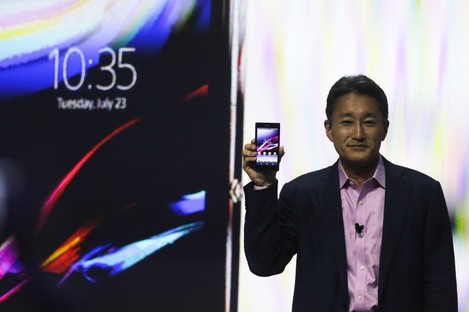 Sony CEO Kazuo Hirai with one of the company's Xperia smartphones.