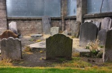 What's being done about historic gravestones at the 'Cabbage Gardens' being vandalised?