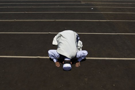 A Libyan man prays during Friday prayers in the rebel-held Benghazi, Libya today