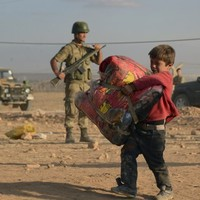 Pics: Thousands of terrified Kurds flee to Turkey to escape Islamic State
