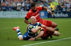 Peter Stringer finishes off a length-of-the-field Bath try against Leicester