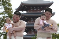 Sumo wrestlers make babies cry on purpose - but that's a good thing