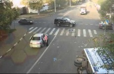 Luckiest cyclist in Russia has insanely close call with car and lorry