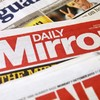 British newspaper group admits liability in four cases of phone hacking