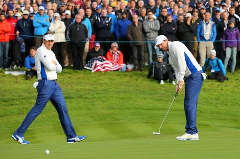 Rory McIlroy and Ian Poulter battled back to get a very important half-point for Europe.