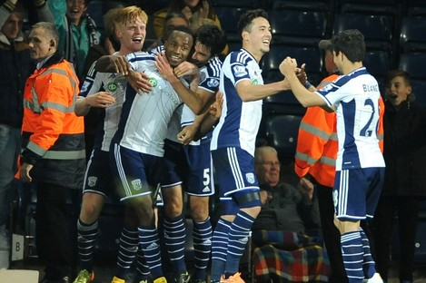 The West Brom players celebrate.