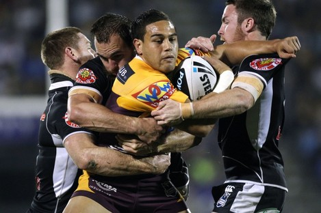 Te'o makes a powerful carry for the Brisbane Broncos in 2010.