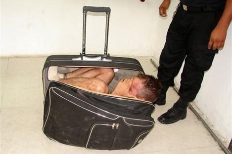 Photo taken Saturday showing Juan Ramirez Tijerina inside the suitcase.