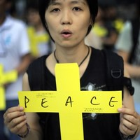 Thousands gather for defiant peace rally in Hong Kong