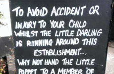 Pub defends sign which offers to 'nail noisy children to a table'