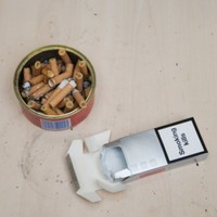 "Photos on cigarette boxes ""will reduce amount of smokers"""