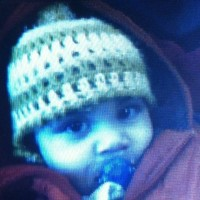 Woman charged over death of toddler Hassan Khan