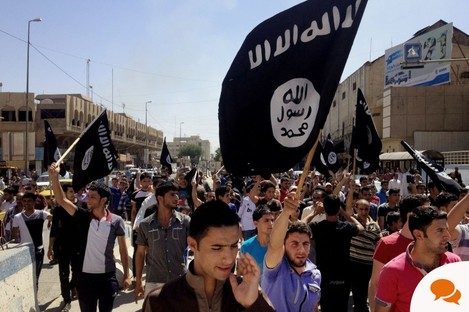 Demonstrators chant pro-al-Qaeda-inspired Islamic State of Iraq and the Levant (ISIL) as they carry al-Qaida flags in front of the provincial government headquarters in Mosul, Iraq.