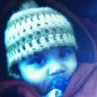 Woman charged with murder of two-year-old Hassan Khan
