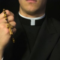 Priest who won property dispute with former partner 'taking time away from Church'