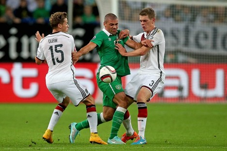 Jonathan Walters put under pressure by Erik Durm and Matthias Ginter in the recent Ireland-Germany clash.