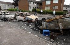 Six injured in rioting as police van rammed by hijacked bus