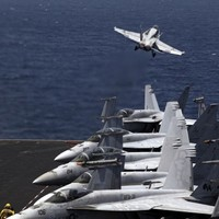 US-led air strikes have killed 553 people in Syria in a month