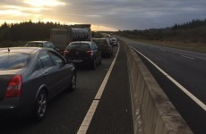 An overturned car is causing major delays at Mitchelstown