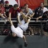 In pictures: Fan nearly falls from stands during homer derby