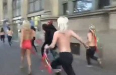 Riot cop suffers embarrassing fail while chasing topless women
