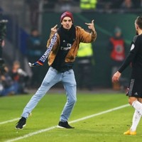 Scarf-wielding supporter run across pitch and slaps Bayern Munich's Franck Ribery
