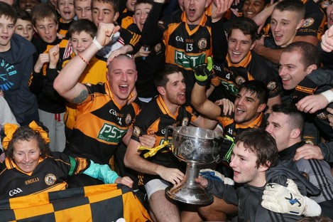 Kieran Donaghy and captain Barry Shanahan celebrate with the Austin Stacks fans.