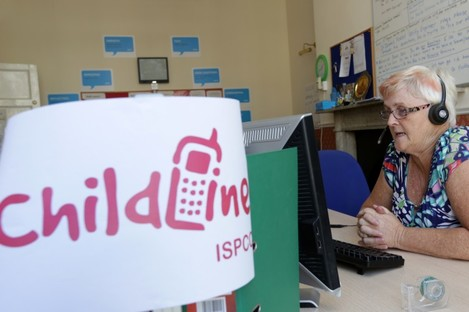 A Childline volunteer answers calls.