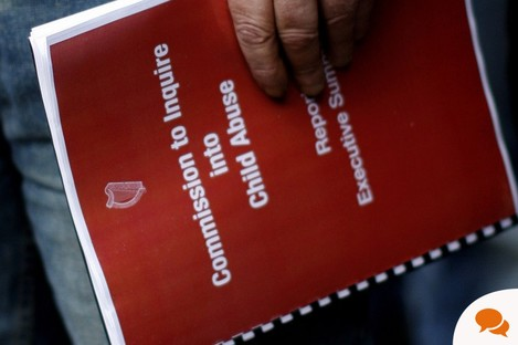 A man holds a copy of the Ryan report on clerical child abuse