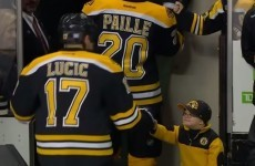 Young hockey fan in heart-warming moment with entire Boston Bruins team