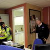 Why is Johnny Logan singing Hold Me Now in a Garda station?