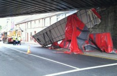 Lorry rear ripped off as it hits bridge