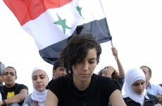 Syrian forces open fire on protesters, killing 14