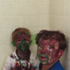 Two little kids get covered in paint, try desperately to pretend nothing is different