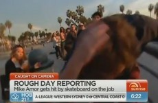 Reporter takes flying skateboard to back of the head on live TV
