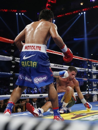 Pacquiao knocks down challenger SIX times in latest defence - calls out Mayweather again