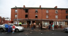 Baby thrown from window as family escape three-storey house blaze
