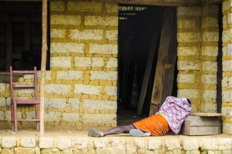 A man with the Ebola virus lying outside his house in Freetown, Sierra Leone