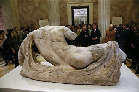 Hermitage director Mikhail Piotrovsky, center left, and British Museum director Neil MacGregor attend the opening of the exhibition on Greek art with the marble sculpture of the river god Ilissos, in front, in the Hermitage in St. Petersburg, Russia.