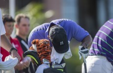 Tiger Woods stops to vomit on the first hole, makes birdie anyway