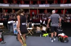 Elton John falling out of his chair at a tennis match