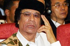 Could Gaddafi step down from power but remain in Libya?